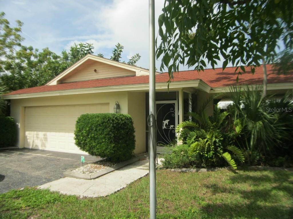 This is the front entrance of 450 Coral Creek Drive. - Single Family Home for sale at 450 Coral Creek Dr, Placida, FL 33946 - MLS Number is D5901346
