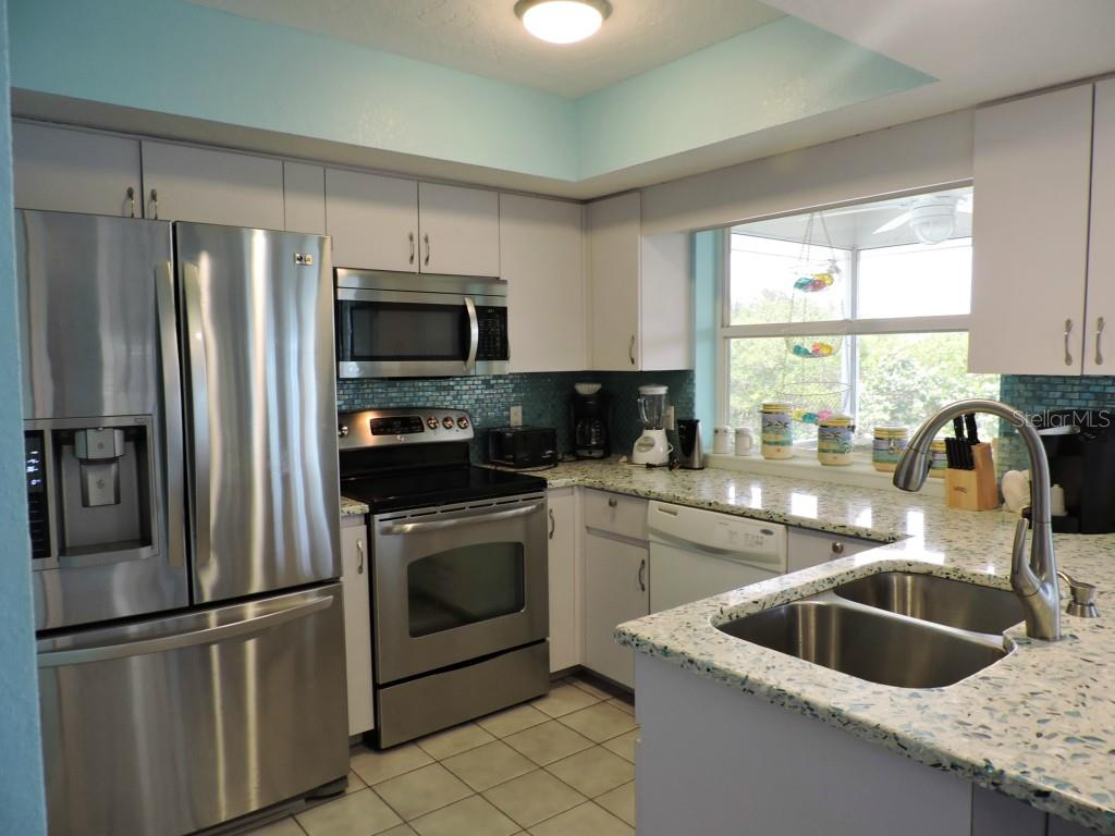 Kitchen. - Single Family Home for sale at 120 Bocilla Dr, Placida, FL 33946 - MLS Number is D5907510