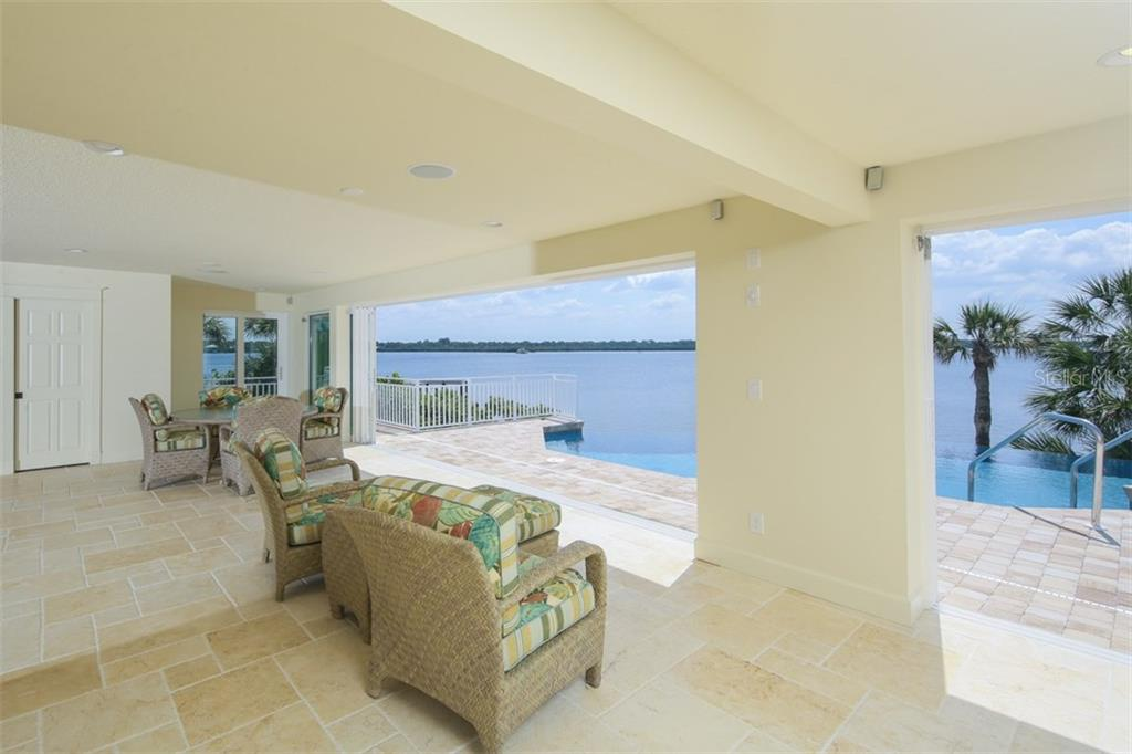 Florida Room with Pool and Water View - Single Family Home for sale at 7295 Manasota Key Rd, Englewood, FL 34223 - MLS Number is D5911936