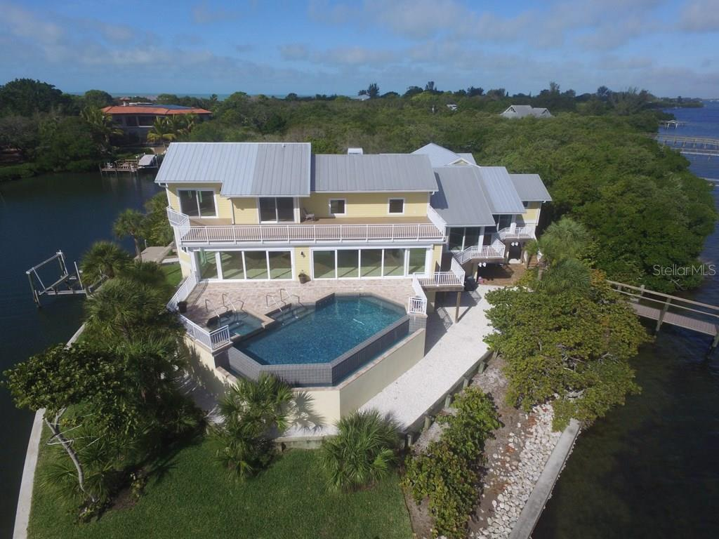 Back Lanai and Pool - Single Family Home for sale at 7295 Manasota Key Rd, Englewood, FL 34223 - MLS Number is D5911936