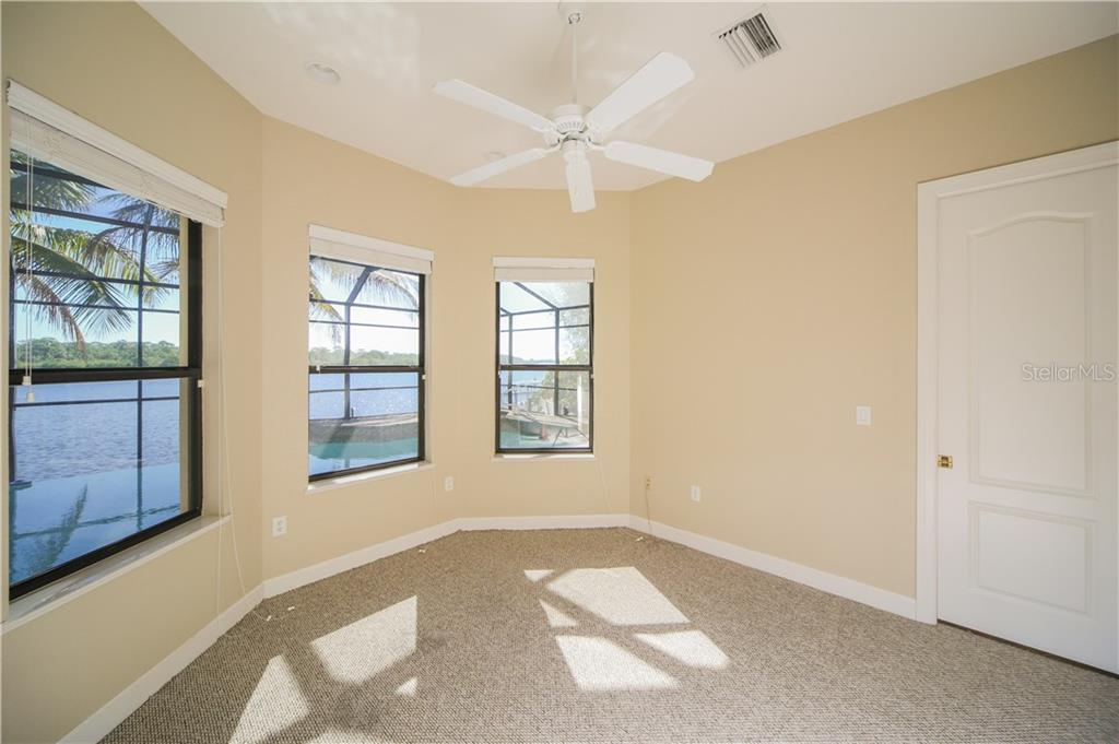 Sitting Room / Office off of Master Bedroom with fabulous views of pool & water - Single Family Home for sale at 550 Coral Creek Dr, Placida, FL 33946 - MLS Number is D5917129