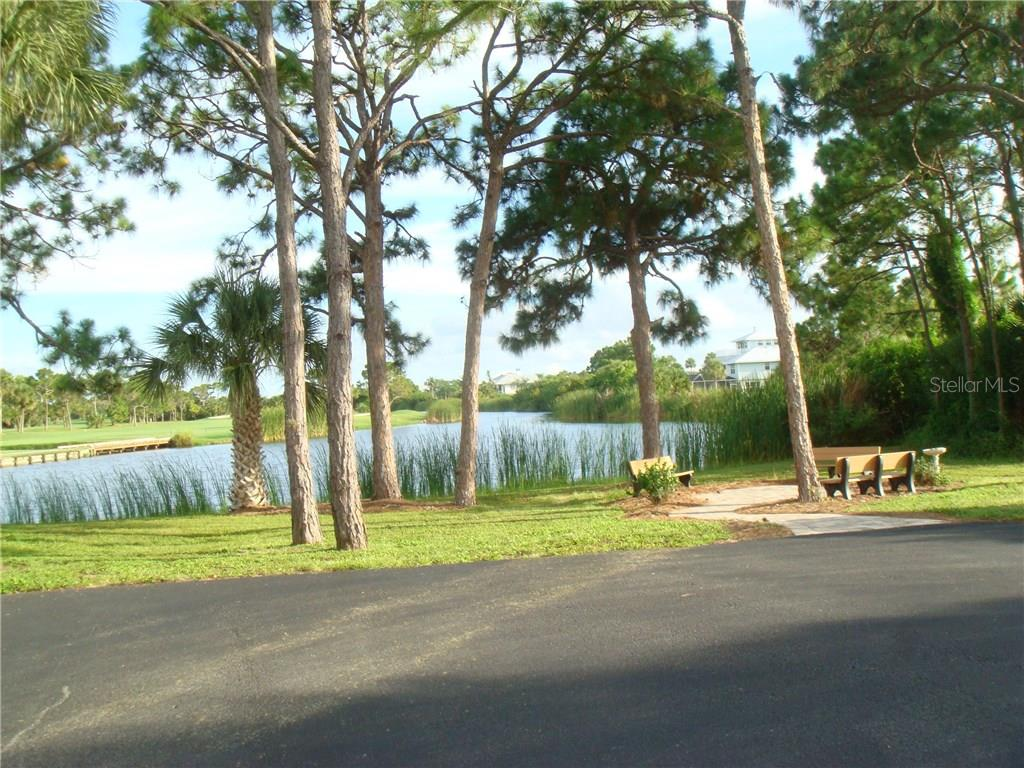 View of a Lemon Bay Golf pond and community park from the mailbox area. This park provides residents with a peaceful setting for quiet contemplation and social interactions. - Vacant Land for sale at 9980 Eagle Preserve Dr, Englewood, FL 34224 - MLS Number is D5917467