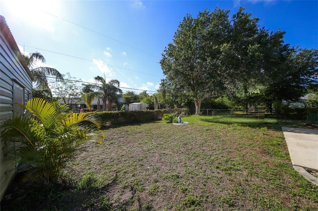 Backyard - Single Family Home for sale at 7044 Quigley St, Englewood, FL 34224 - MLS Number is D5918526