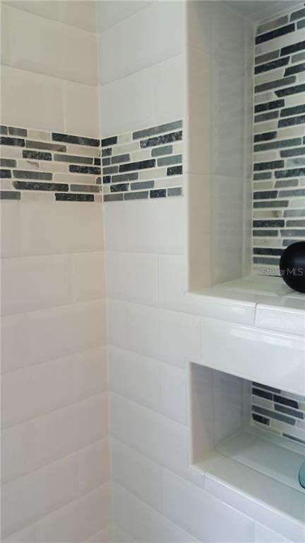Newly tiled guest bathroom - Single Family Home for sale at 1570 Scotten St, Port Charlotte, FL 33952 - MLS Number is D5918705