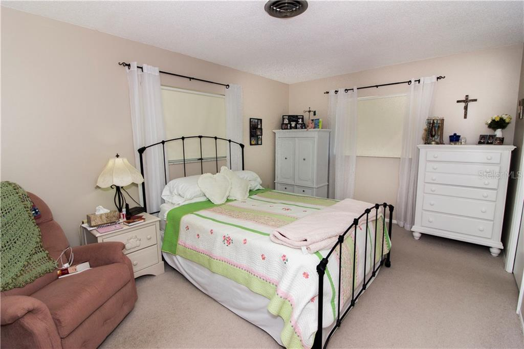 The master bedroom when it was furnished. - Single Family Home for sale at 21068 Halden Ave, Port Charlotte, FL 33952 - MLS Number is D5918749