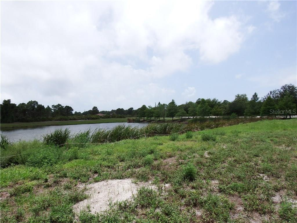 Semi cleared lot at 3 Sabot Ct, Placida FL 33946.  Lot is 10,593 sq. ft, dimensions are 46x90x167x168.  Water frontage is 167 ft. - Vacant Land for sale at 3 Sabot Ct, Placida, FL 33946 - MLS Number is D5918855