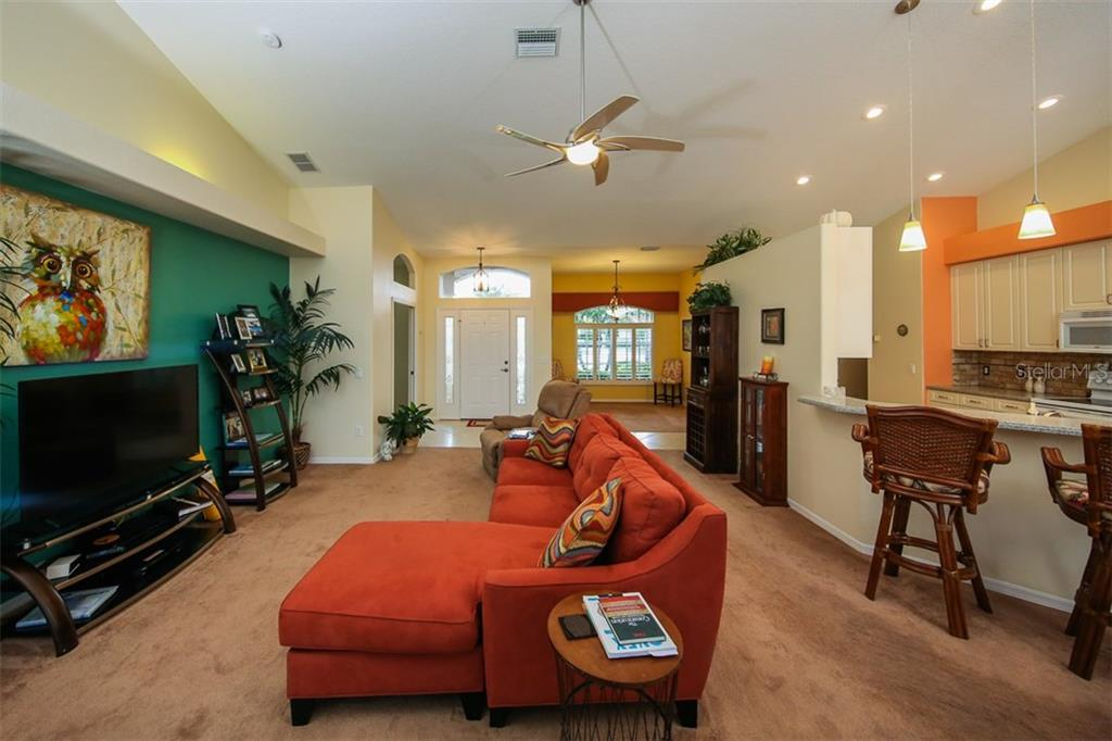 Entrance, Living Area and Breakfast Bar - Single Family Home for sale at 5660 Riviera Ct, North Port, FL 34287 - MLS Number is D5919107