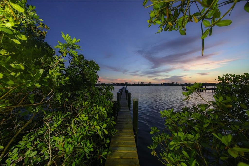 250' dock on Lemon Bay/boat lift - Single Family Home for sale at 1850 Bayshore Dr, Englewood, FL 34223 - MLS Number is D5919513