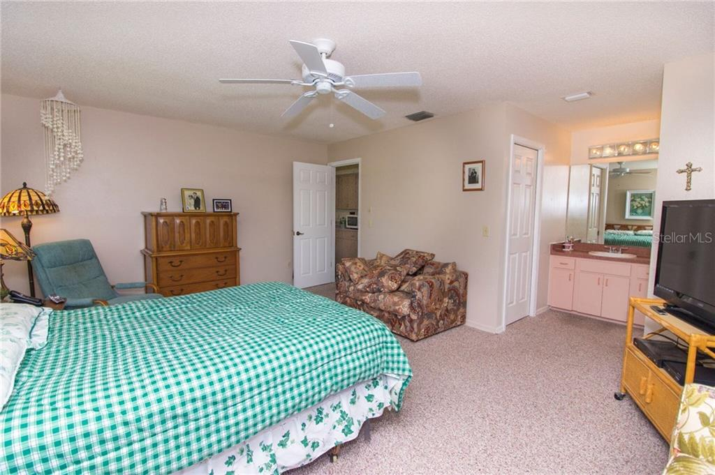 Master bedroom - Single Family Home for sale at 7029 Peacock Ln, Englewood, FL 34224 - MLS Number is D5919625
