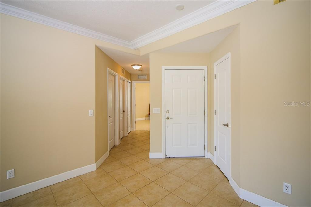 tile through the entire home - Single Family Home for sale at 414 Tomoka Dr, Englewood, FL 34223 - MLS Number is D5919831