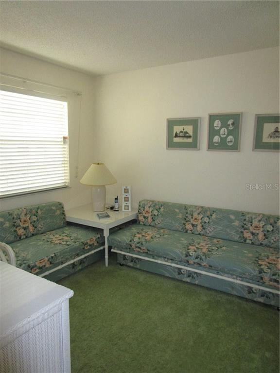 Guest bedroom has carpeted flooring & wall closet. - Condo for sale at 6796 Gasparilla Pines Blvd #14, Englewood, FL 34224 - MLS Number is D5919892