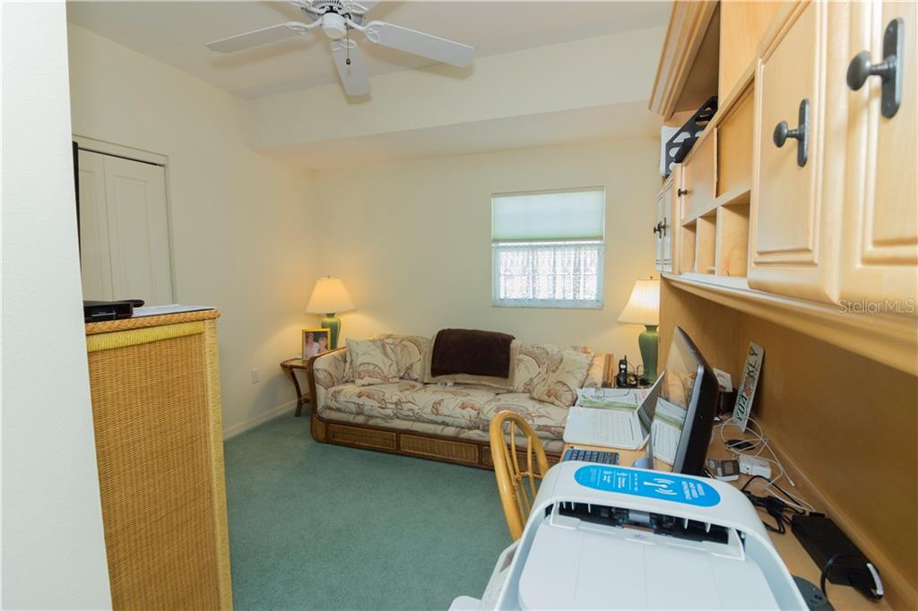 This upstairs bedroom is currently set up as an office. - Single Family Home for sale at 1439 Deer Creek Dr, Englewood, FL 34223 - MLS Number is D5921060