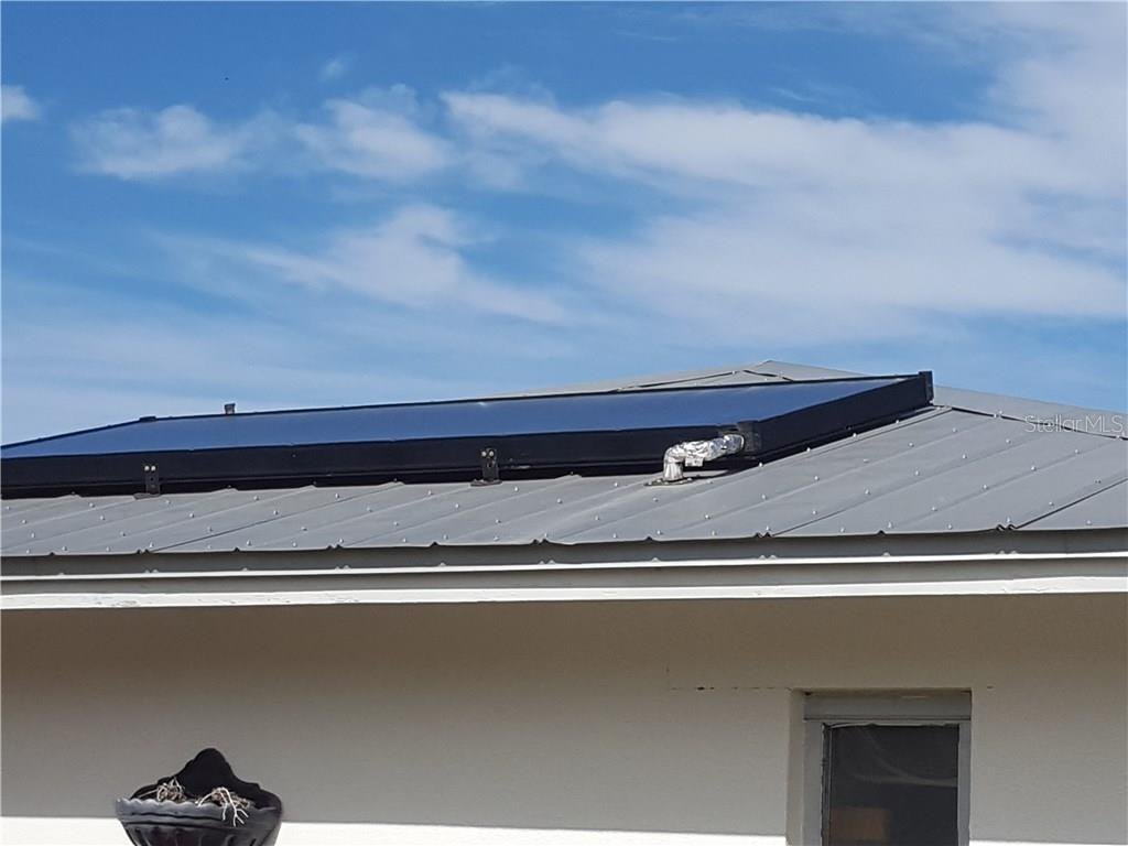 The solar panel for the hot water heater. - Single Family Home for sale at 360 E Wentworth Cir, Englewood, FL 34223 - MLS Number is D5921470