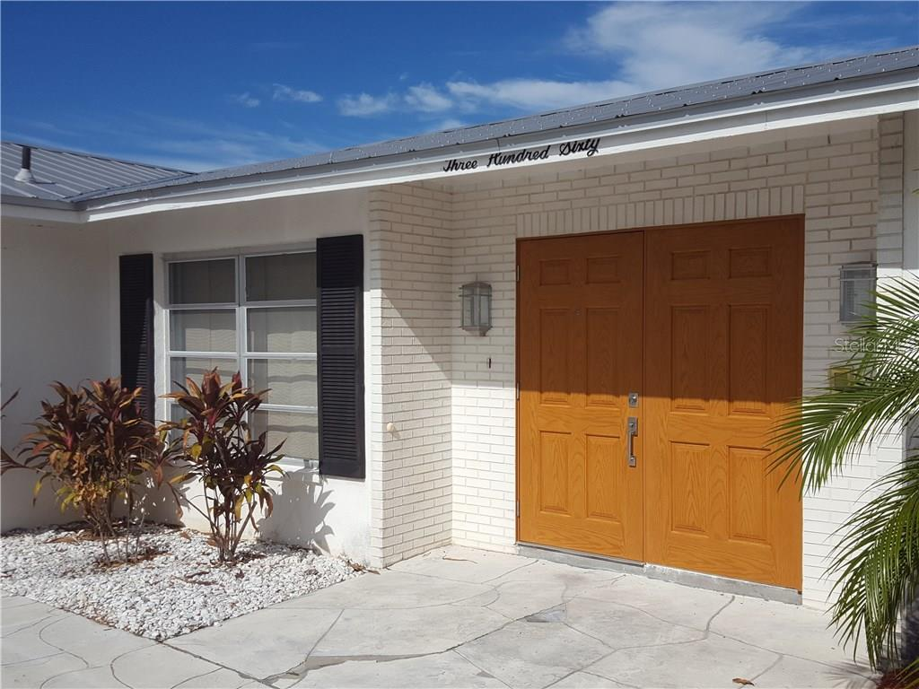 Now let's look inside.  The double front doors were recently upgraded. - Single Family Home for sale at 360 E Wentworth Cir, Englewood, FL 34223 - MLS Number is D5921470