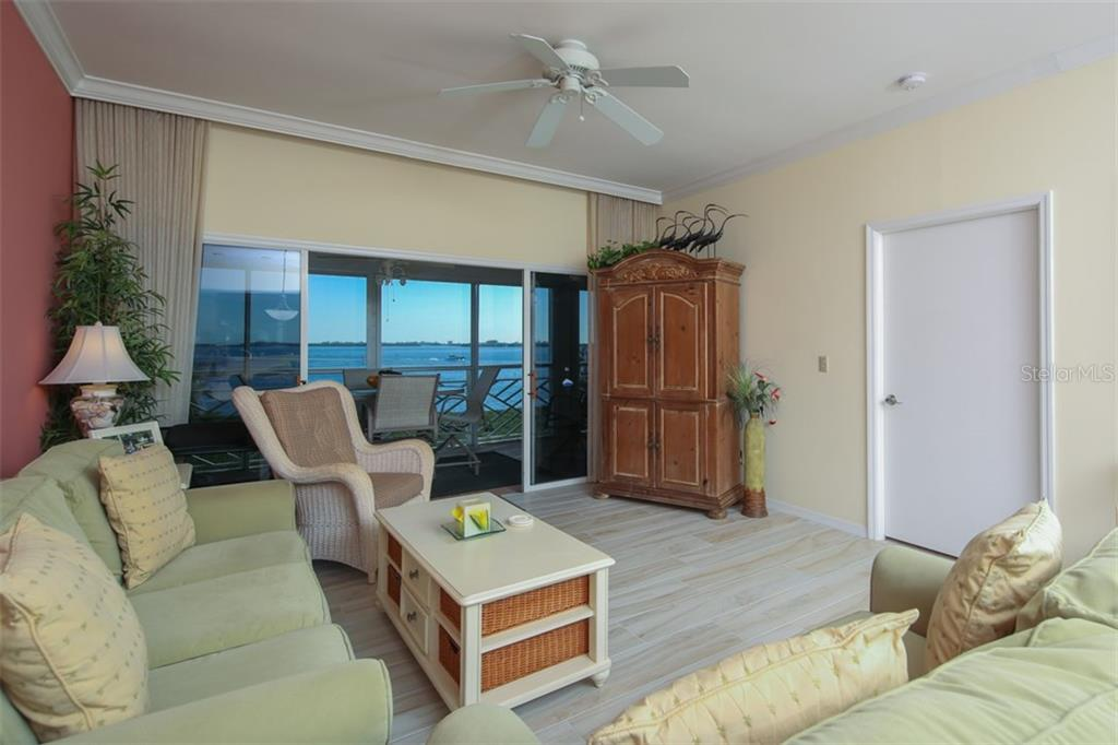 Living Room overlooking Intracoastal - Condo for sale at 11000 Placida Rd #309, Placida, FL 33946 - MLS Number is D5921681