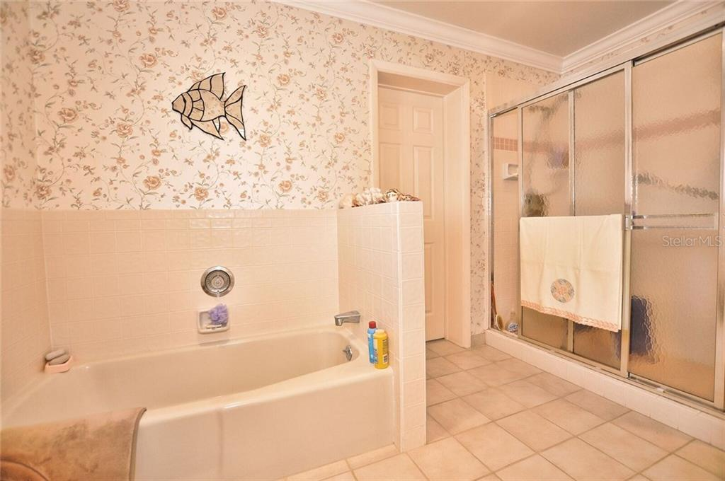 Master bathroom - Single Family Home for sale at 9 Pine Ridge Way, Englewood, FL 34223 - MLS Number is D5921839