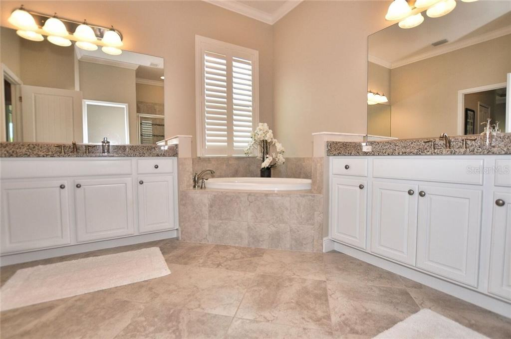 Master bathroom - Single Family Home for sale at 8944 Scallop Way, Placida, FL 33946 - MLS Number is D5923173