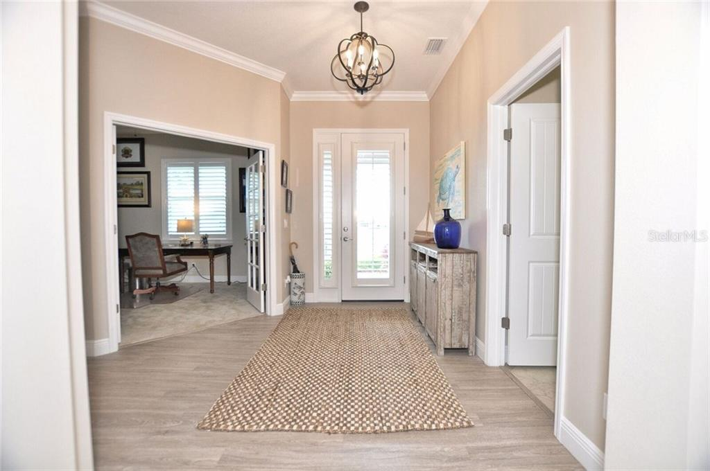 Entryway - Single Family Home for sale at 8944 Scallop Way, Placida, FL 33946 - MLS Number is D5923173