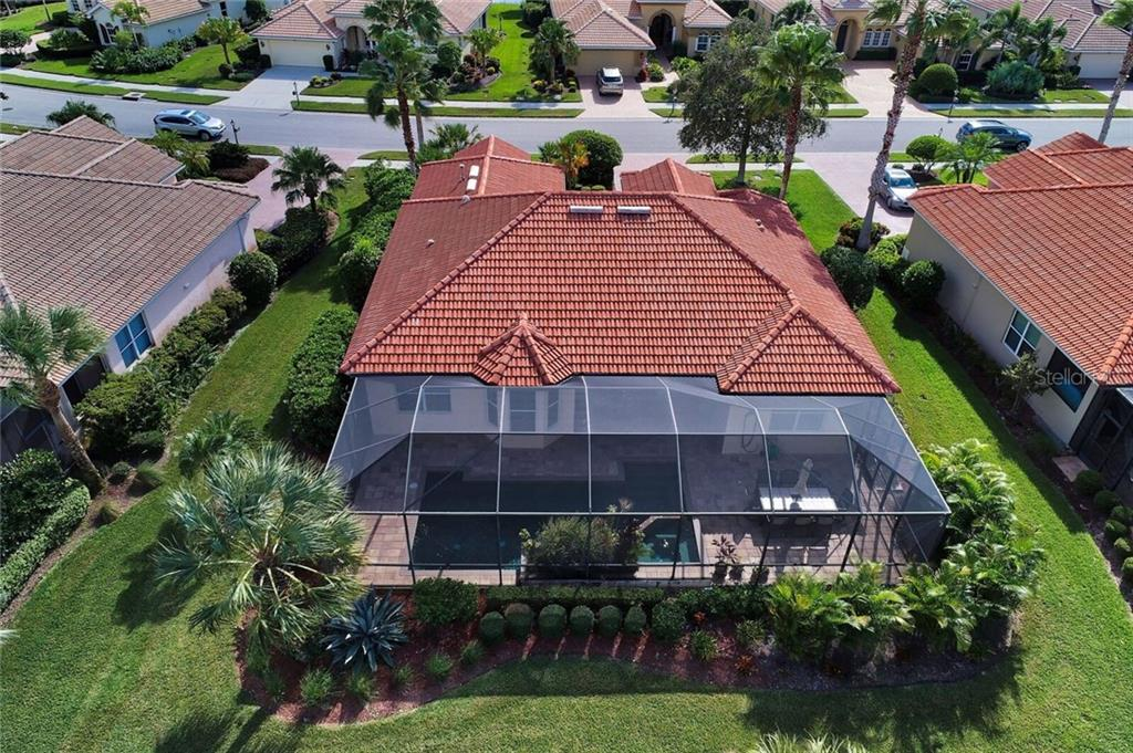 Back aerial view of 409 Montelluna Drive - Single Family Home for sale at 409 Montelluna Drive, North Venice, FL 34275 - MLS Number is D5923522