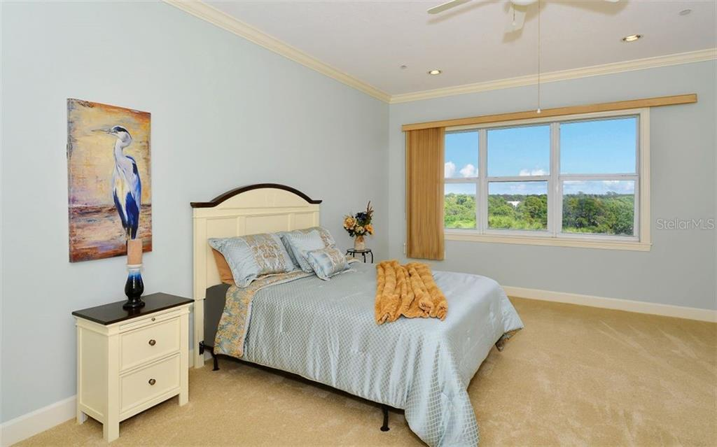 Spacious Master Bedroom - Condo for sale at 8561 Amberjack Cir #402, Englewood, FL 34224 - MLS Number is D5923600