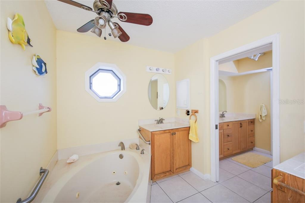 Master Bath separate vanities & jetted tub - Single Family Home for sale at 332 Eden Dr, Englewood, FL 34223 - MLS Number is D6100012