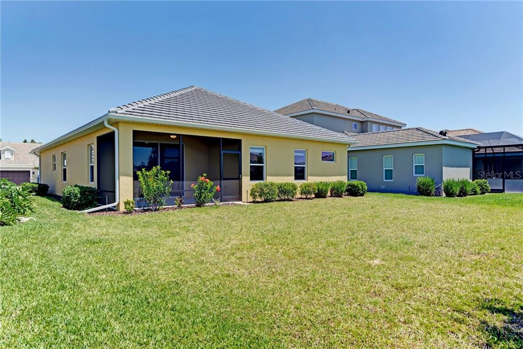 Rear of the home. - Single Family Home for sale at 141 Avens Dr, Nokomis, FL 34275 - MLS Number is D6100104