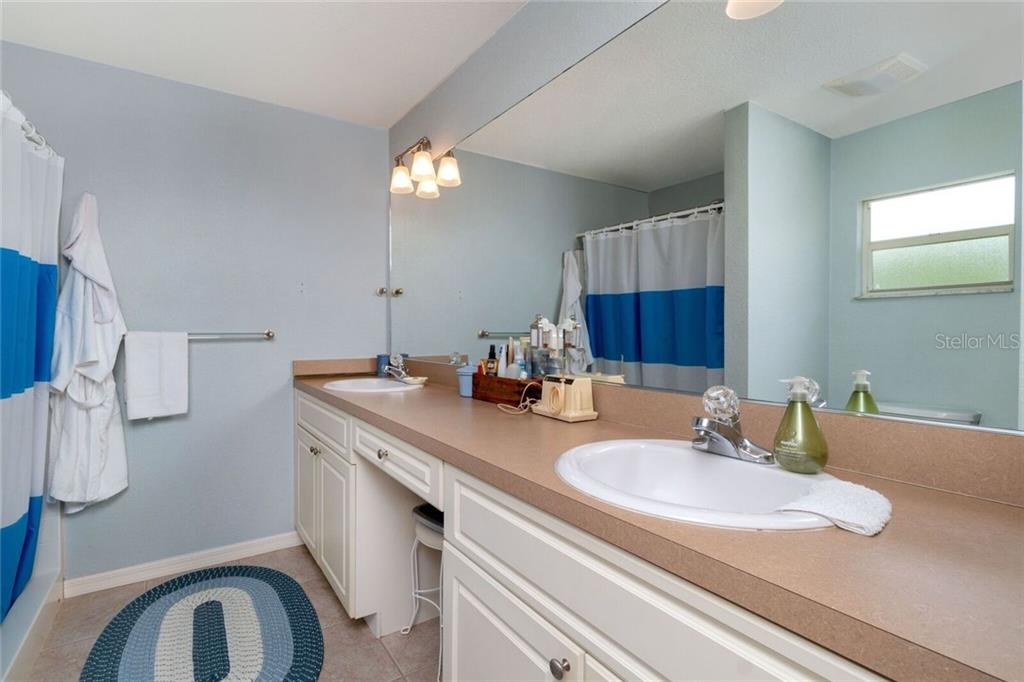 Master Bathroom with double sink - Single Family Home for sale at 11205 Gulfstream Blvd, Port Charlotte, FL 33981 - MLS Number is D6100390