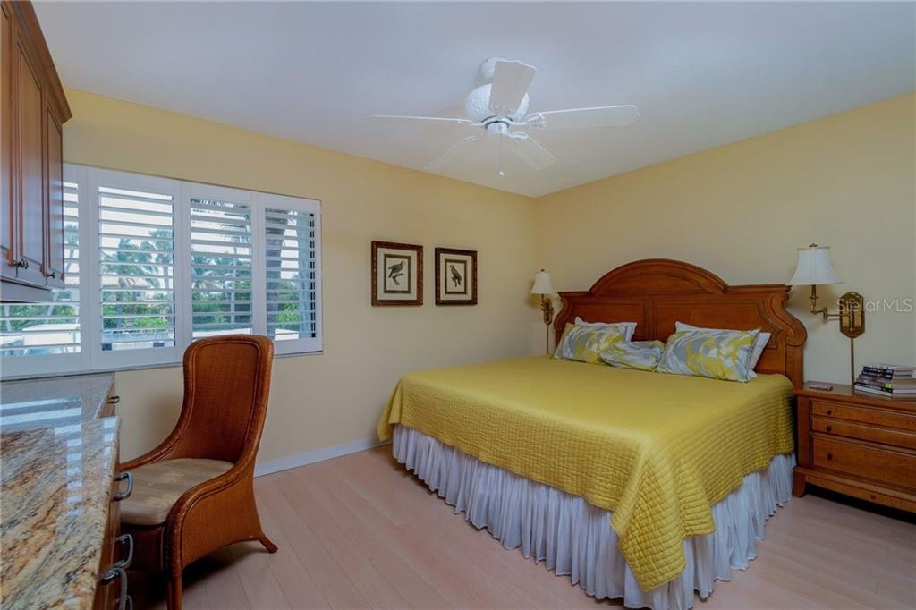 Master Bedroom with Desk - Condo for sale at 500 Park Blvd S #57, Venice, FL 34285 - MLS Number is D6100773