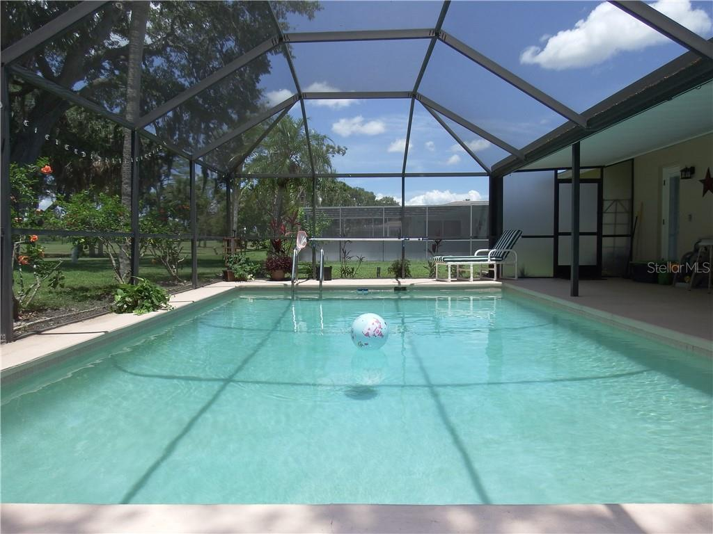 Screened in Lanai, Pool overlooking 17 hole, Par 3.  New lower screens on Lanai. - Single Family Home for sale at 12 Oakland Hills Pl, Rotonda West, FL 33947 - MLS Number is D6100794