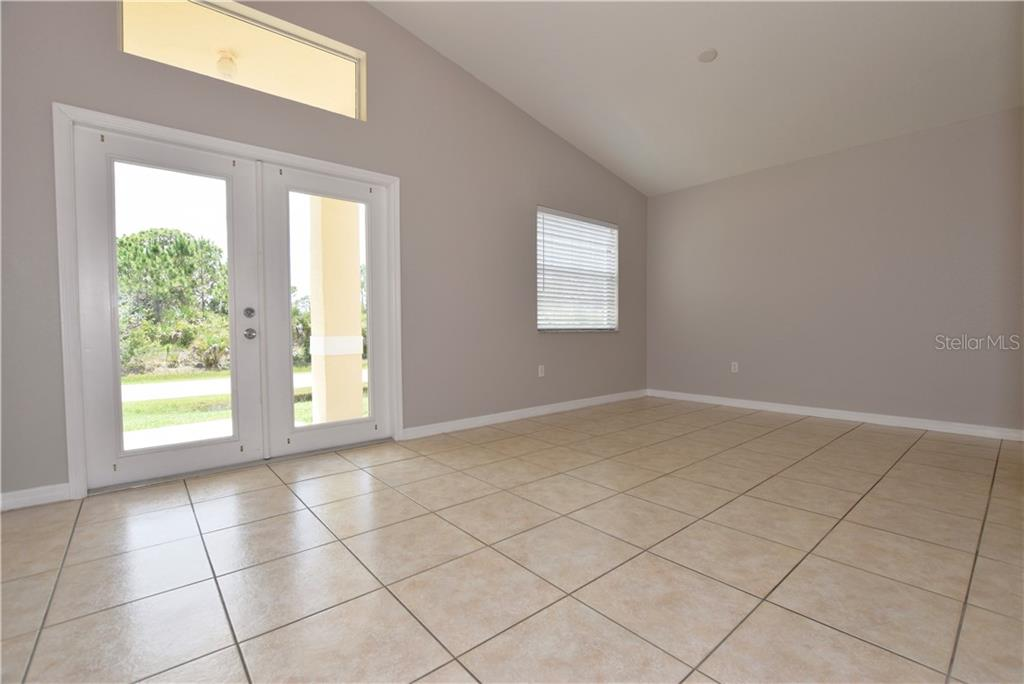 Bonus area at the front of the home, formal dining, living room, whatever you want to make it. - Single Family Home for sale at 4414 Callaway St, Port Charlotte, FL 33981 - MLS Number is D6100799