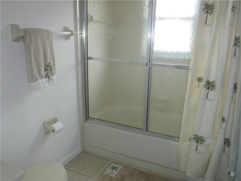 2nd bath shower and toilet area is separated from sink by a door for privacy. - Single Family Home for sale at 3001 Pellam Blvd, Port Charlotte, FL 33948 - MLS Number is D6101282