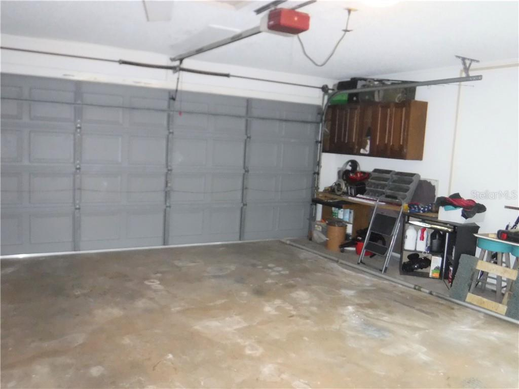 Two car garage. - Single Family Home for sale at 3001 Pellam Blvd, Port Charlotte, FL 33948 - MLS Number is D6101282