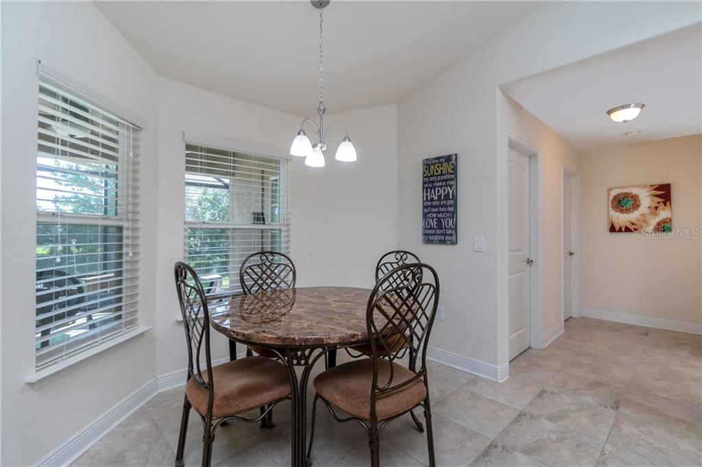 A welcoming place to share a meal. - Single Family Home for sale at 71 Mariner Ln, Rotonda West, FL 33947 - MLS Number is D6101950