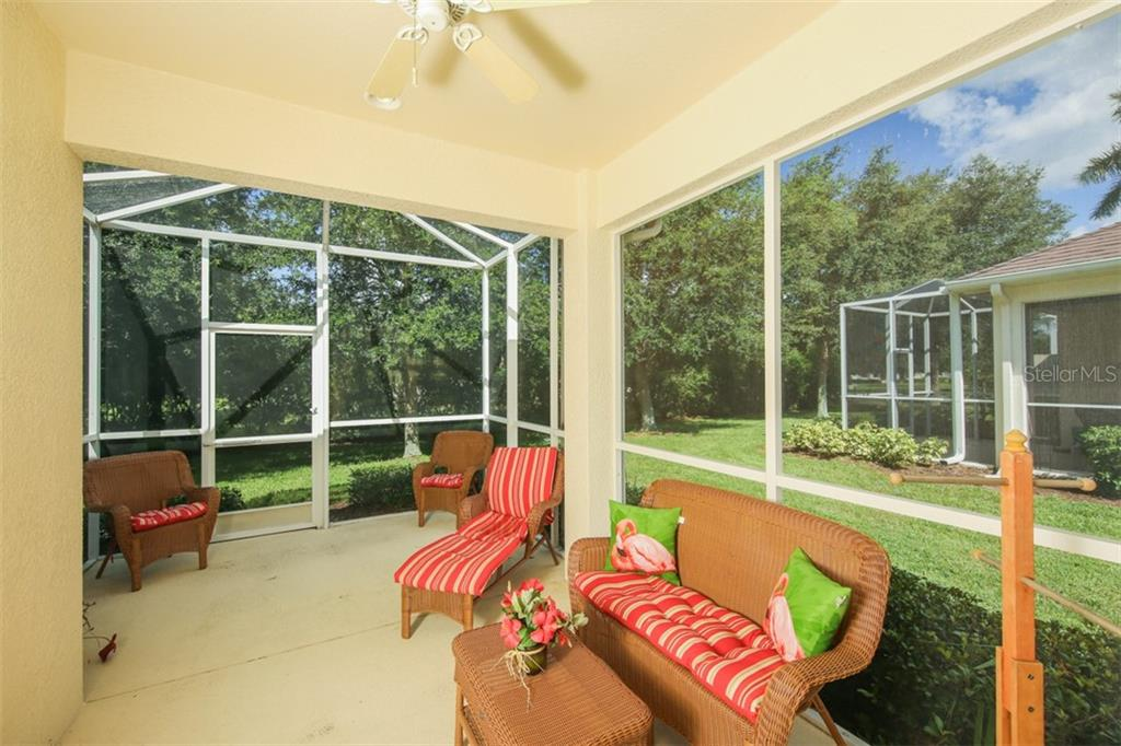 This private lanai with fully screened enclosure is one of the features that were added to this home by the builder. This is definitely money well spent and money you don't have to spend when you move in because it is already here for your enjoyment. - Villa for sale at 29704 Niagara Ct, Englewood, FL 34223 - MLS Number is D6102386