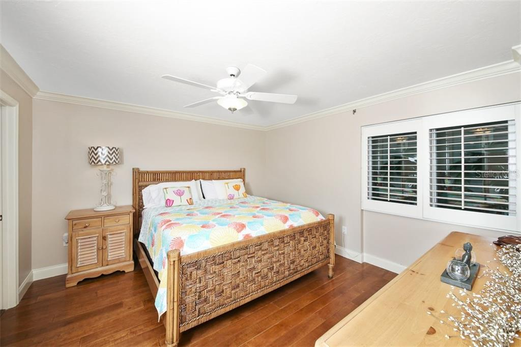 Bedroom #2-upgraded wood flooring & plantation shutters - Condo for sale at 11000 Placida Rd #2103, Placida, FL 33946 - MLS Number is D6102674