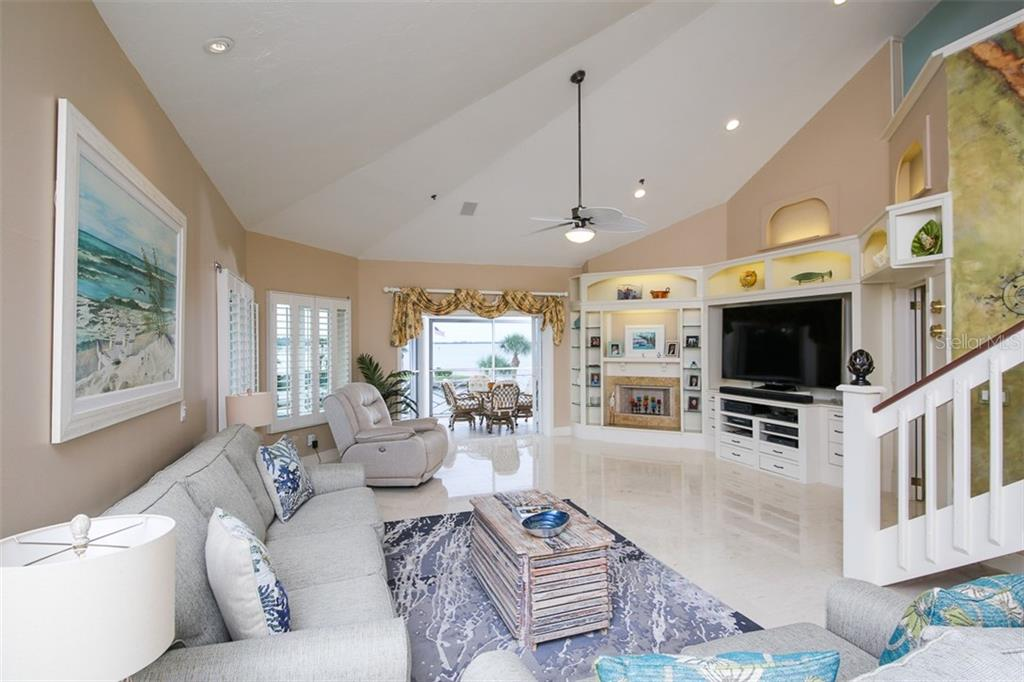 Living room overlooking Intracoastal & marina - Condo for sale at 11000 Placida Rd #2103, Placida, FL 33946 - MLS Number is D6102674