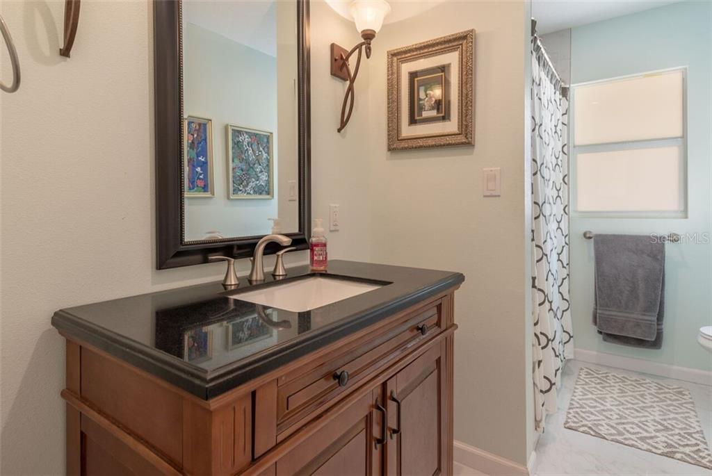 The guest bath is fully modernized and features a large linen closet with several lighting choices. - Single Family Home for sale at 7339 Hawkins Rd, Sarasota, FL 34241 - MLS Number is D6102762