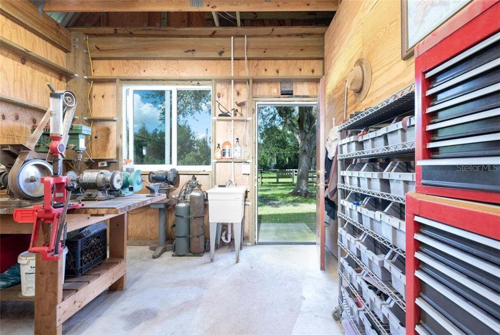 The barn has a large workshop with fantastic lighting.  It's only a short walk to the house - Single Family Home for sale at 7339 Hawkins Rd, Sarasota, FL 34241 - MLS Number is D6102762