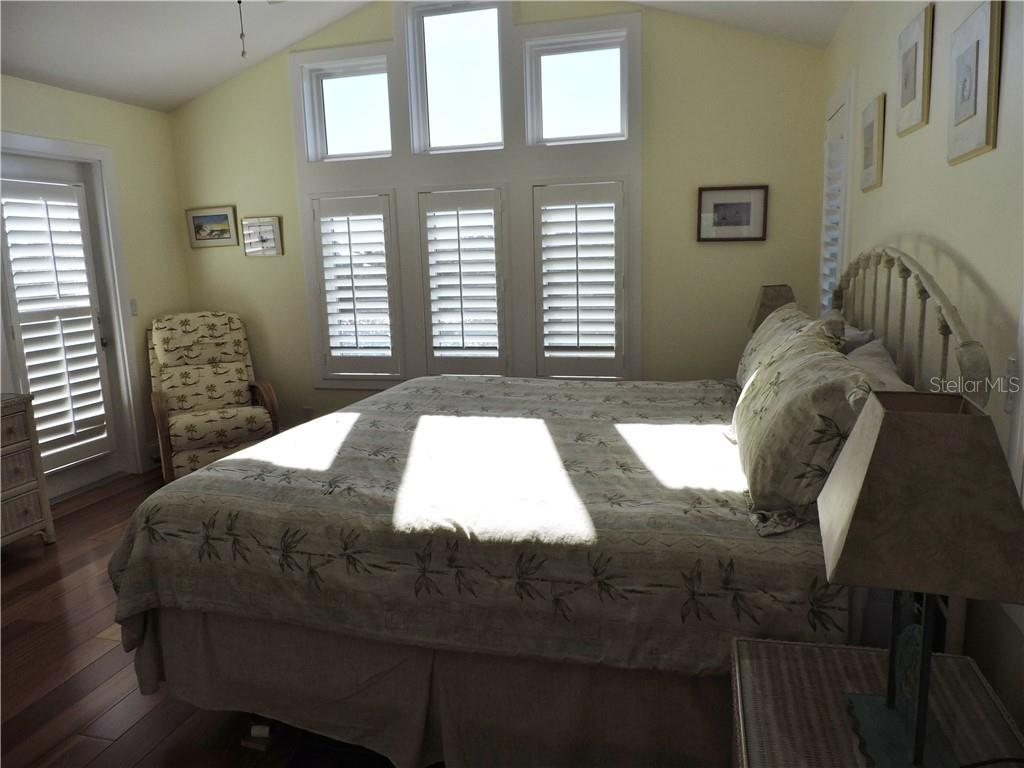 Bedroom Suite 2. - Single Family Home for sale at 111 Kettle Harbor Dr, Placida, FL 33946 - MLS Number is D6104218