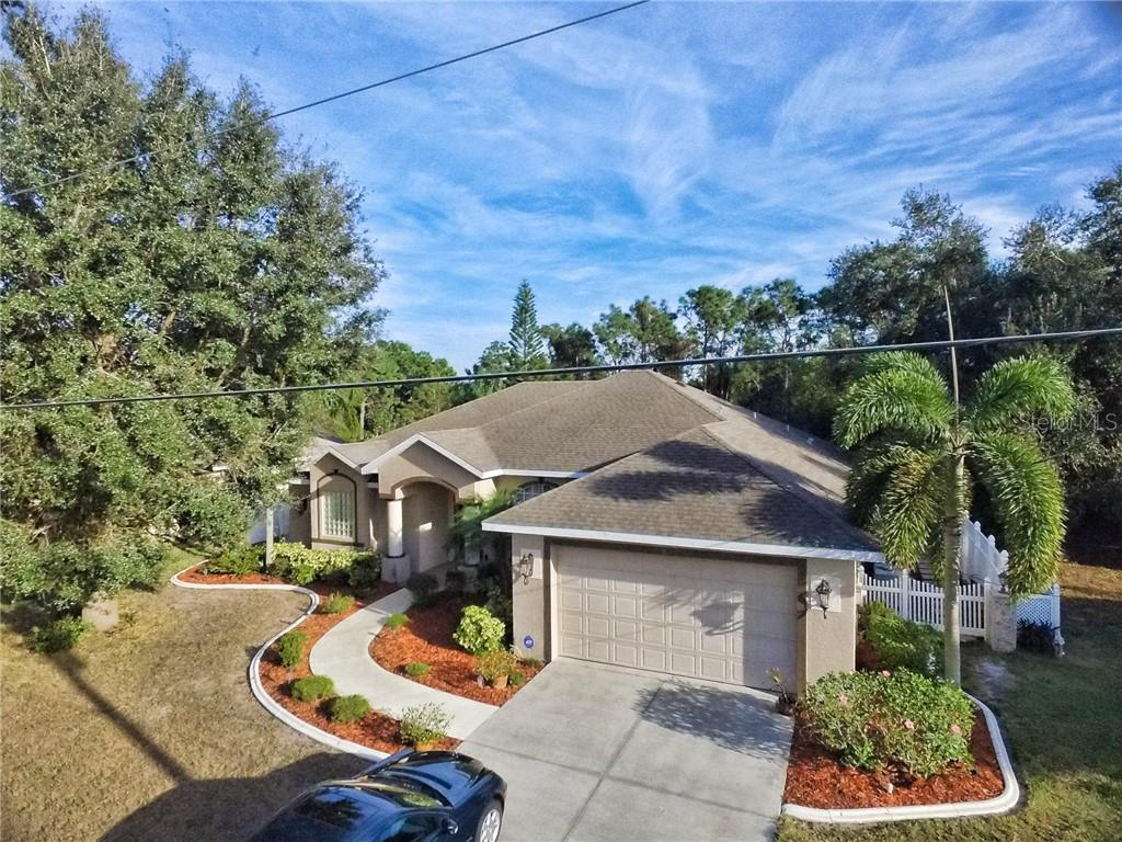 8 Medalist Cr, fenced in yard, 3 bedrooms, 2 baths, pool, 2 car garage, privacy with golf course views. - Single Family Home for sale at 8 Medalist Cir, Rotonda West, FL 33947 - MLS Number is D6104474