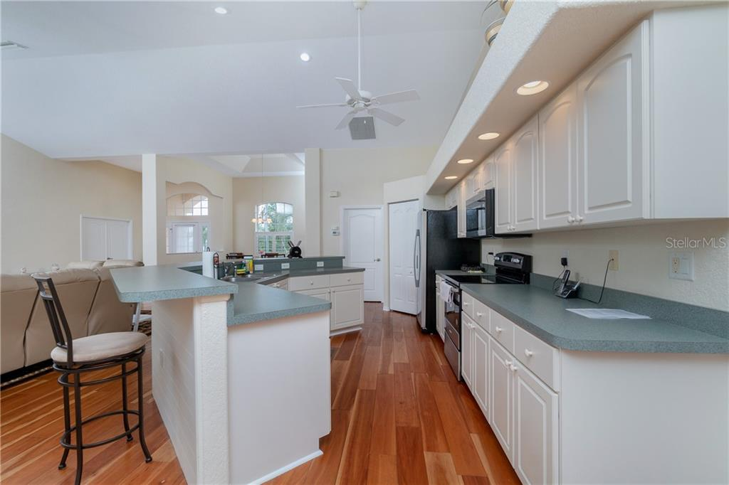 Kitchen is open to all main living areas and makes it easy to entertain. - Single Family Home for sale at 30 Medalist Way, Rotonda West, FL 33947 - MLS Number is D6106239
