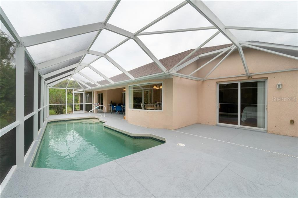 Screened pool has a fountain and is extended which would make a great place for lounge chairs and umbrella. - Single Family Home for sale at 30 Medalist Way, Rotonda West, FL 33947 - MLS Number is D6106239
