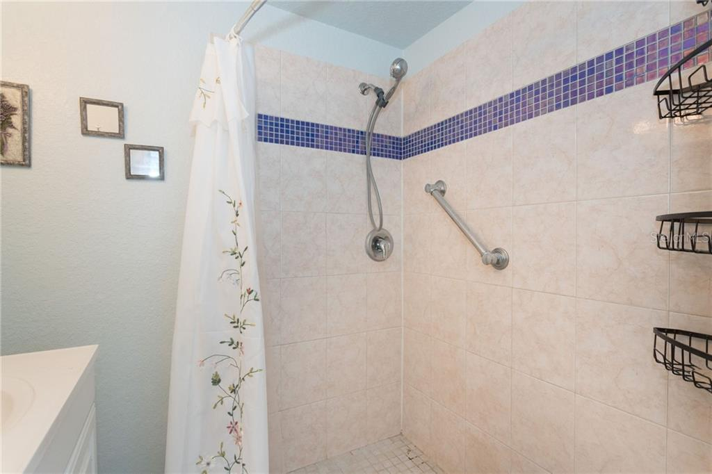 2nd bathroom with walk-in shower - Single Family Home for sale at 190 W Wentworth St, Englewood, FL 34223 - MLS Number is D6106918