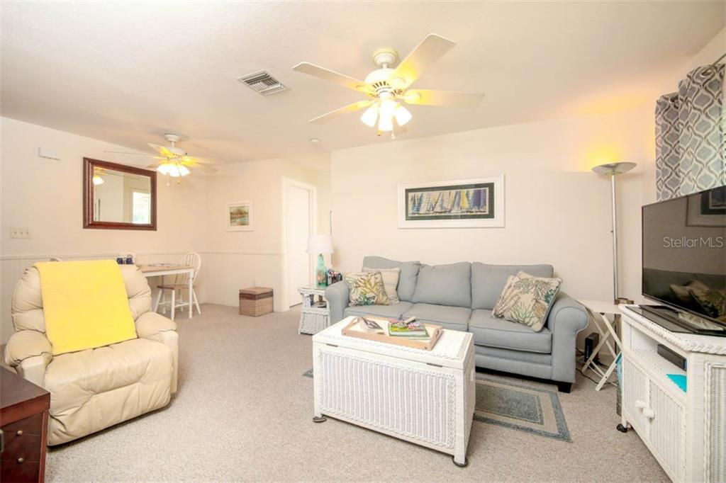 another view of family room - Single Family Home for sale at 913 Tropical Ave Nw, Port Charlotte, FL 33948 - MLS Number is D6108061