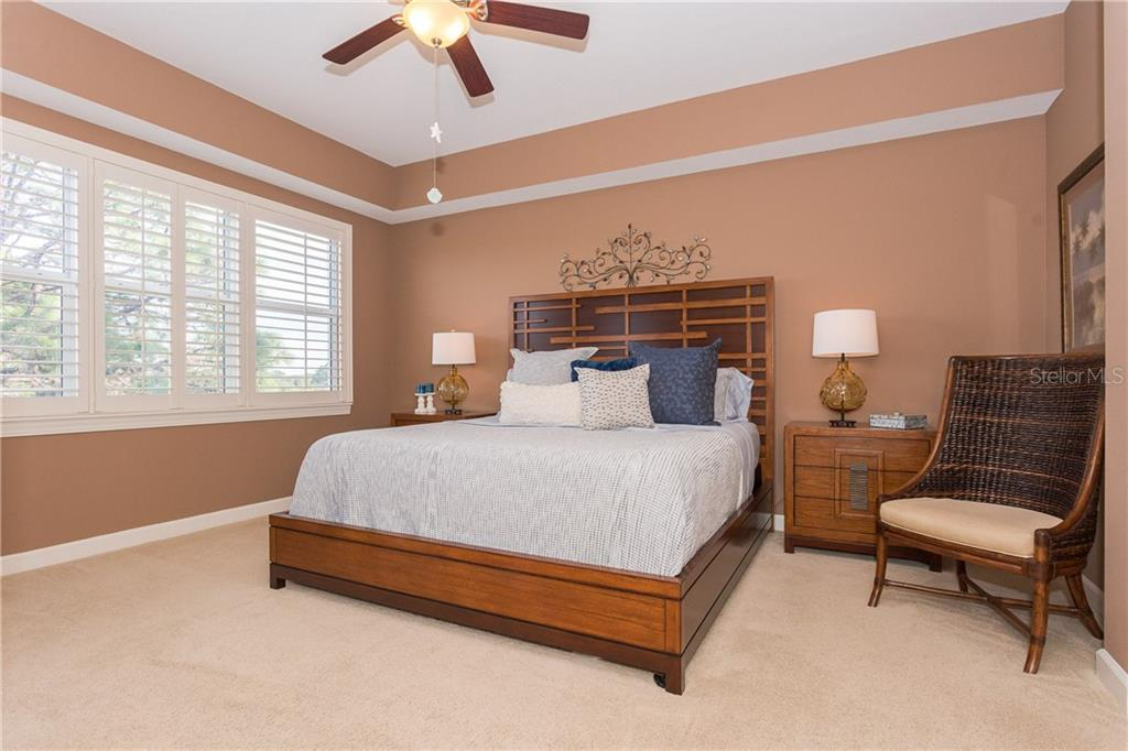 Master Bedroom that has enough room for a King Size Bed suite - Condo for sale at 8561 Amberjack Cir #202, Englewood, FL 34224 - MLS Number is D6109771