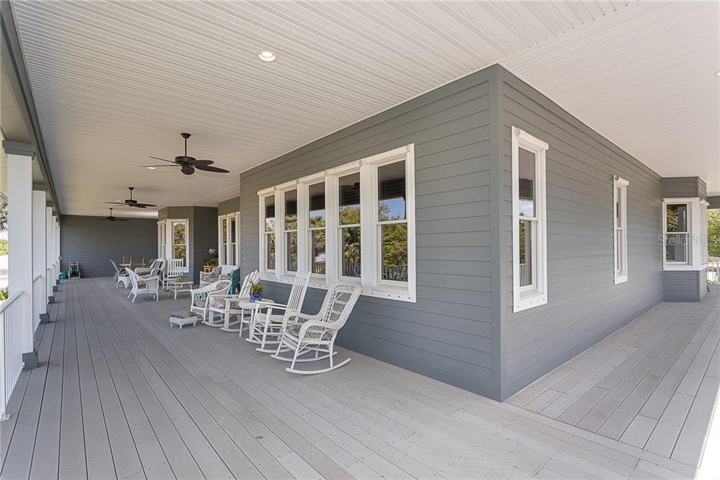 Easy care composite decking and HardiPlank siding means you can spend more time enjoying your porch, not working on maintaining it. - Single Family Home for sale at 550 S Oxford Dr, Englewood, FL 34223 - MLS Number is D6111512