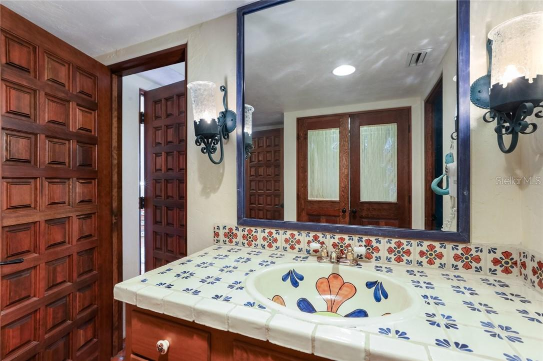 Charming tile work in guest bath. Detail of Mission style doors - Single Family Home for sale at 4090 Loomis Ave, Boca Grande, FL 33921 - MLS Number is D6112331