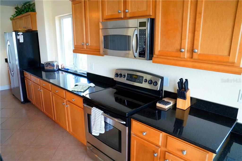 Another view of the kitchen - Condo for sale at 2245 N Beach Rd #304, Englewood, FL 34223 - MLS Number is D6112346
