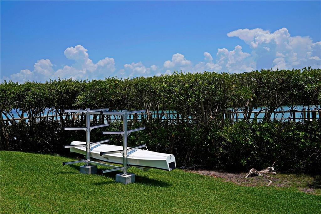 Community kayak rack.  First come first serve - Condo for sale at 2245 N Beach Rd #304, Englewood, FL 34223 - MLS Number is D6112346