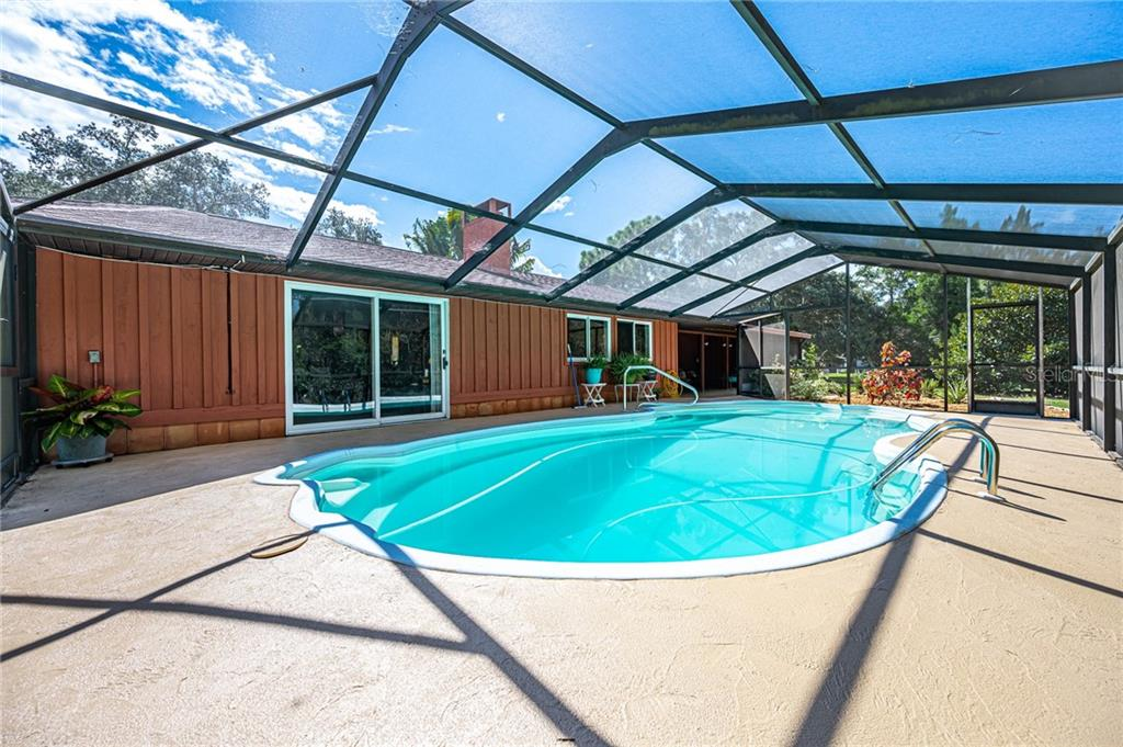 Single Family Home for sale at 2085 E Dolphin Dr, Englewood, FL 34223 - MLS Number is D6113485
